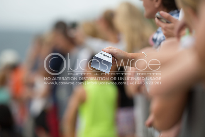 Spectators cheer on competitors with Douglas cow bells, June 1, 2014 - TRIATHLON : Coral Coast 5150 Triathlon, Cairns Airport Adventure Festival, Four Mile Beach, Port Douglas, Queensland, Australia. Credit: Lucas Wroe (Lucas Wroe)