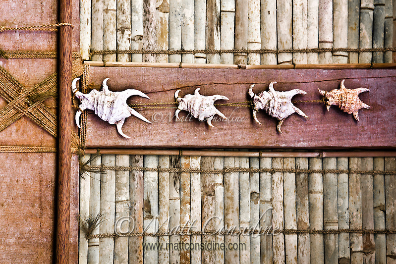 Trochus shells decorate the wall of a traditional Men's House in Yap. Men and women can gather in their own separate communal housing during the day.  The traditional house is actually far more than a place to gather, the building and maintenance and use of the house is integral to the passing on of skills and culture from one generation to another, Yap Micronesia. (Photo by Matt Considine - Images of Asia Collection) (Matt Considine)