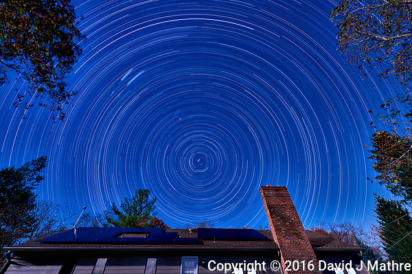 Star trails looking north. The north star isn't exactly due north. Composite of 110 images taken with a Nikon D810a camera and 14-24 mm f/2.8 lens (ISO 200, 14 mm, f/8, 300 sec). (David J Mathre)