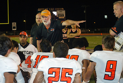 Refugio High School head football coach Jason Herring talks to his team about their performance, Sept. 29, 2017, in Seguin, Texas. The team lost to Navarro High School 21-17, bringing their record to 2-1. Many of the team members have been sleeping in the team's weight room after their homes were destroyed by Hurricane Harvey in late August. (Photo by Carmen K. Sisson) (Carmen K. Sisson/Cloudybright)
