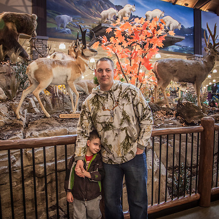 "Air Force fireman Brian Patterson and his four year old son, Justin, on the day of Cabelas retail store opening in South Anchorage.  ""I'm from Montana…this is Heaven!""  ginabrian07@gmail.com (© Clark James Mishler)"