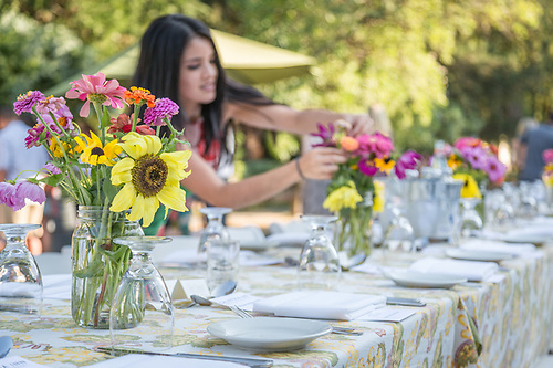 Melisssa Cuellar prepares the Calistoga Inn table at the Calistoga Harvest celebration on Lincoln Avenue in downtown Calistoga. (Clark James Mishler)