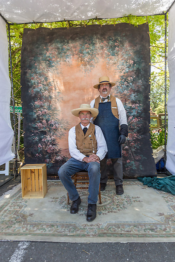 "Photographer Bruce Morton with his assistant, Alan, pose inside their portable ""tintype"" portrait studio at the Petaluma Antique Fair. (Clark James Mishler)"