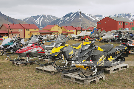 LONGYEARBYEN, NORWAY - SEPTEMBER 01, 2011: View to the snowmobiles parked outside for a short arctic summer in Longyearbyen, Norway. (Dmitry Chulov)