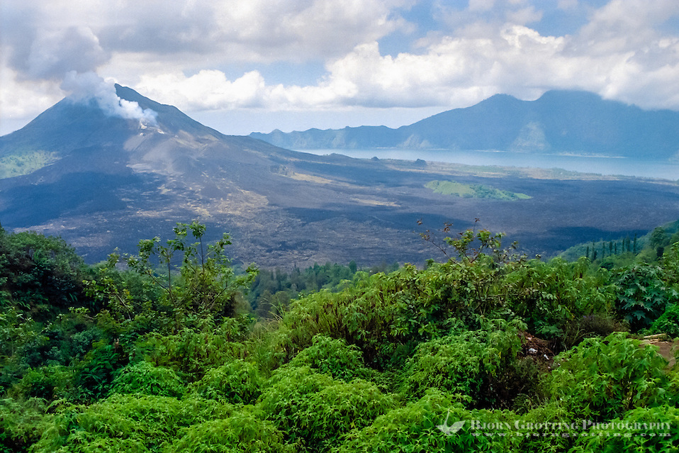 Bali, Bangli, Batur. The crater of the Batur volcano is huge. Located in the center is the newer Batur mountain, with smoke rising from the top. Beneath the mountain is Lake Batur (from Kintamani). (Bjorn Grotting)