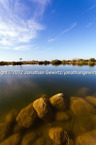 A tranquil pond with submerged rocks just under the surface, in Everglades National Park, Florida. (© 2012 Jonathan Gewirtz / jonathan@gewirtz.net)