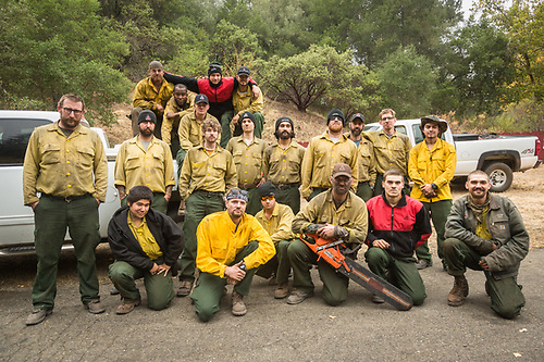 Crew Chief Weston Smith (left) with his PatRick professional fire service crew #85 from Redmond, Oregon take a break in the middle of their 14 day deployment on Petrofied Forest Road west of Calistoga. (Clark James Mishler)