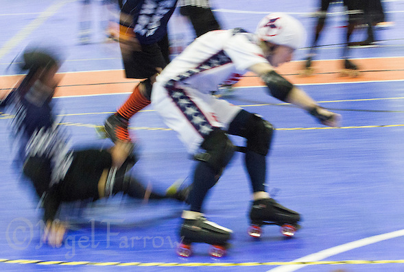 15 MAR 2014 - BIRMINGHAM, GBR - Team USA jammer Jonathan R (in white, blue and red) races past a Power or Scotland blocker during the bout between the two countries at the inaugural Men's Roller Derby World Cup in the Futsal Arena in Birmingham, West Midlands, Great Britain (PHOTO COPYRIGHT © 2014 NIGEL FARROW, ALL RIGHTS RESERVED) (NIGEL FARROW/COPYRIGHT © 2014 NIGEL FARROW : www.nigelfarrow.com)