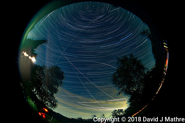 Night Sky Star Trails Image. Composite of 211 images taken with a Nikon D810a camera and 8-15 mm telephoto lens (200 ISO, 10 mm, f/8, 120 sec). (David J Mathre)