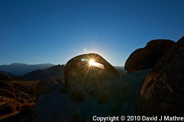 Sunrise Starburst Through Mobius Arch in the Alabama Hills near Lone Pine, California. Image taken with a Nikon D3x and 14-24 mm f/2.8 lens (ISO 100, 24 mm, f/22, 1/60 sec) processed using Capture One Pro 6. (David J Mathre)