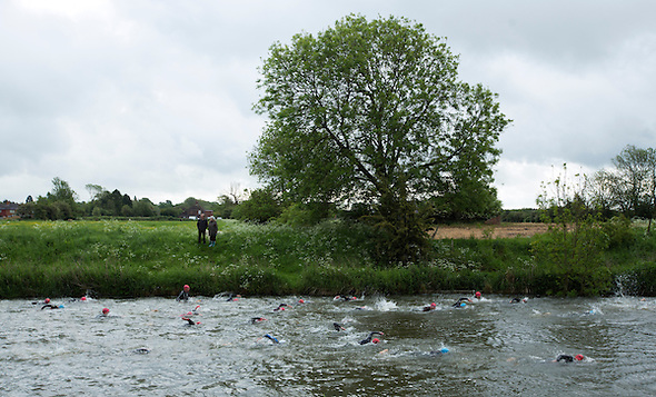 25 MAY 2014 - BRIGG, GBR - Competitors swim along the River Ancholme during the World Quadrathlon Federation 2014 Middle Distance World Championships at the Brigg Bomber in Brigg in Lincolnshire, Great Britain (PHOTO COPYRIGHT © 2014 NIGEL FARROW, ALL RIGHTS RESERVED) (NIGEL FARROW/COPYRIGHT © 2014 NIGEL FARROW : www.nigelfarrow.com)