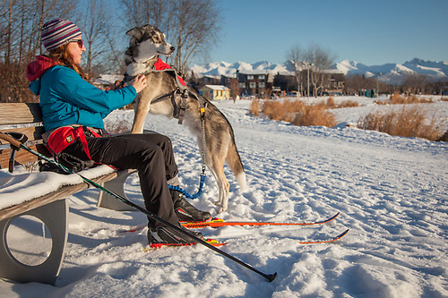Linda Barnack takes a break from skiing with her don, Hatcher, at the west end of Westchester Lagoon, Anchorage  lindabarnack@gmail.com (© Clark James Mishler)