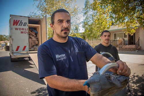 "Professional movers and Tlingit cousins, Justin Sapien and Blake Isbell, deliver our housewares from Alaska to our new home in Calistoga. ""My grandmother was adopted and moved to california as a child. Our's is one of the few Tlingit families in Sanoma County."" mluvj8123@yahoo.com (© Clark James Mishler)"