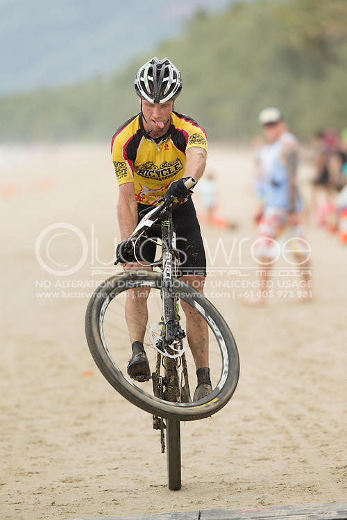 Competitors wheelies his bike at the finish, June 1, 2014 - MOUNTAIN BIKE : RRR Mountain Bike Challenge, Cairns Airport Adventure Festival, Four Mile Beach, Port Douglas, Queensland, Australia. Credit: Lucas Wroe (Lucas Wroe)
