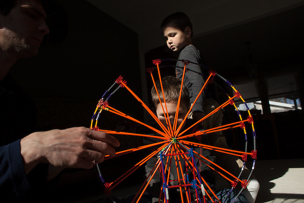 The boys pooled their money to buy a garage sale motorized ferris wheel, which needed a lot of input from Dad to put together. (Kristen Schmid)