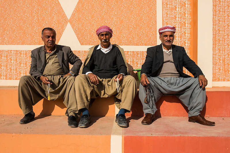 Traditional Kurdish dressed men sitting in the town center of Al-Kosh for their morning chat, Iraq Kurdistan (Michael Runkel)