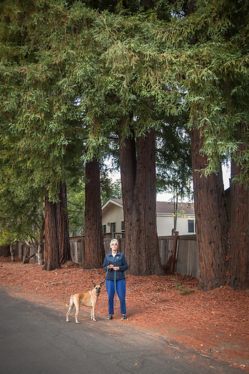 "Lucie with her dog, Sierra, Rancho de Calistoga. ""I live in the trailer park...I like the big trees but the management dosen't like anyone to bend the rules...I'm selling my home...it's too close to the highway."" (© Clark James Mishler)"