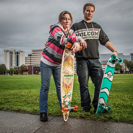 Just returned to Anchorage after summer jobs in Nome, Nicole Curran and Steven Lasley try our their new skate boards on the Delaney Park Strip.  slaveway@hotmail.com (Clark James Mishler)