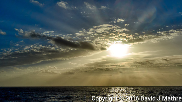 Morning sun, crepuscular rays, and clouds after breakfast from the aft deck of the MV World Odyssey. Leica T camera and 11-23 mm lens (ISO 100, 23 mm, f/14, 1/1000 sec). (David J Mathre)