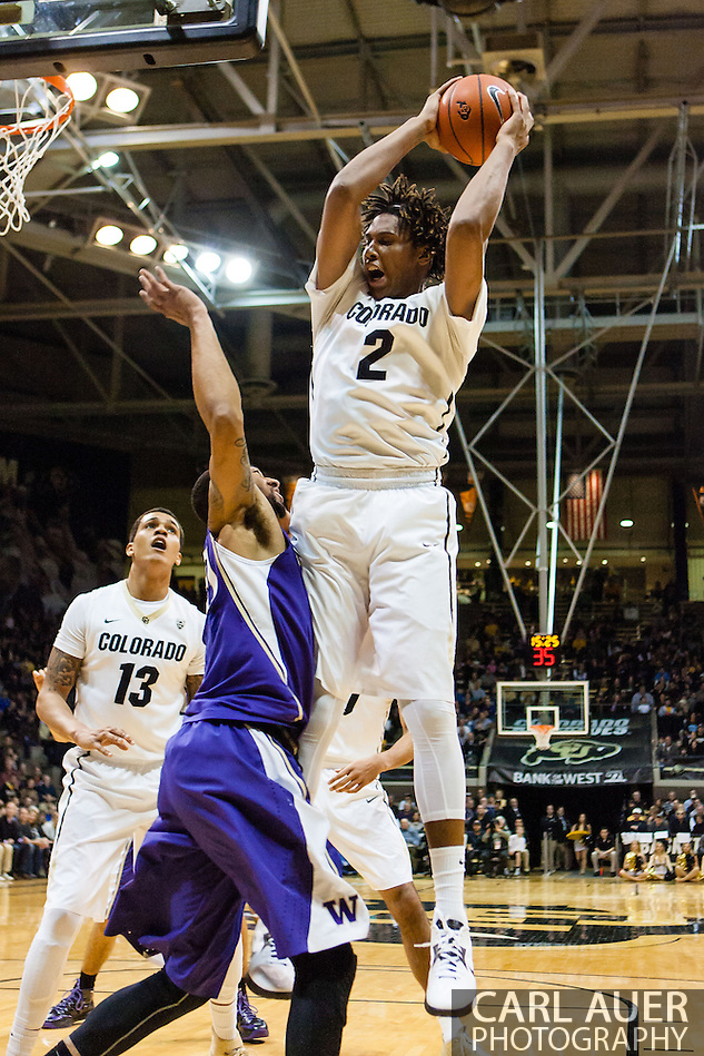 February 9th, 2014:  Colorado Buffaloes sophomore forward Xavier Johnson (2) grabs a offensive rebound the first half of action in the NCAA Basketball game between the Washington Huskies and the University of Colorado Buffaloes at the Coors Events Center in Boulder, Colorado (Carl Auer/ZUMAPRESS.com)