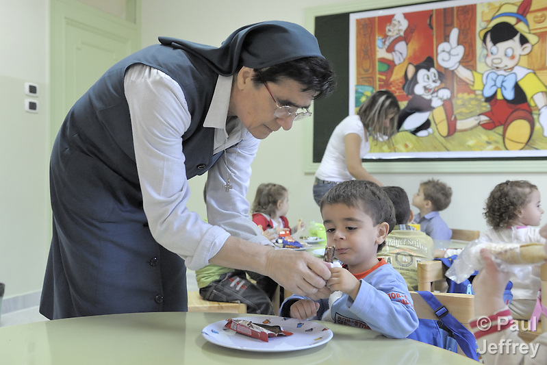 Pierrina Esso, a Sacred Heart Sister, helps students in a class in the Morningstar School, an elementary program in Aleppo, Syria, for Iraqi refugee children as well as Syrian children, which is sponsored by the Chaldean Catholic Church. The Chaldean Bishop of Aleppo, Antoine Audo, has spoken out vociferously on behalf of Iraqi refugees, and his church provides educational and other services to some of the 60,000 Iraqis living in the Aleppo area. (Paul Jeffrey)