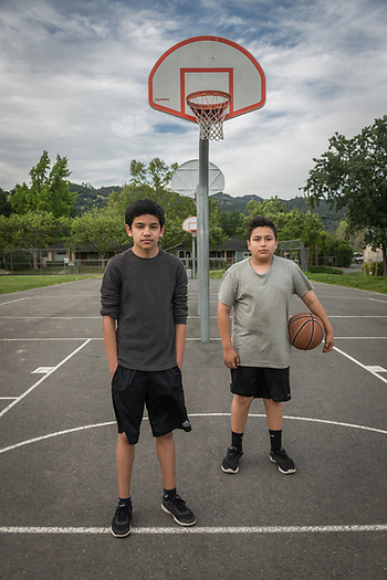 Eighth graders and best friends Carlos Salomon and Yahir Carrillo take a break from shooting hoops at Calistoga High School. (Clark James Mishler)