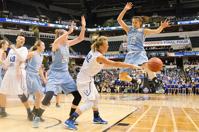 4/4/16 – Indianapolis, IN – Tufts guard Michelle Wu, LA'16, kicks the ball off the court to prevent Thomas More from completing a pass in the NCAA Div. III women's basketball championship on Monday, April 4, 2016. (Evan Sayles / The Tufts Daily) (Evan Sayles / The Tufts Daily)