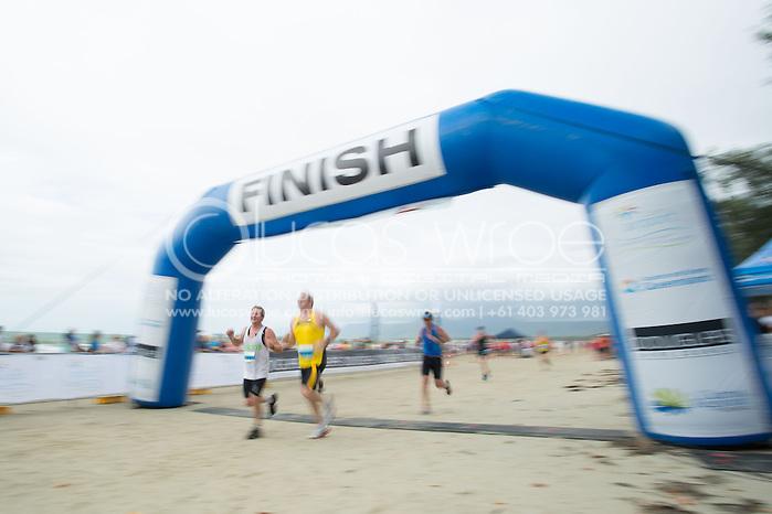 Age Group Competitors finish, June 1, 2014 - TRIATHLON : Coral Coast 5150 Triathlon, Cairns Airport Adventure Festival, Four Mile Beach, Port Douglas, Queensland, Australia. Credit: Lucas Wroe (Lucas Wroe)
