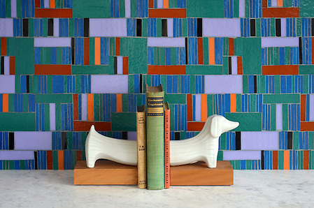 Kente, a hand cut glass mosaic shown in Athos, Juhl, Blair, Rhode, Rolly and Obsidian, is part of the Erin Adams Collection for New Ravenna Mosaics. Dachshund bookends are from Jonathan Adler. Take the next step: prices, samples and design help, http://www.newravenna.com/showrooms/ (Sara Baldwin)
