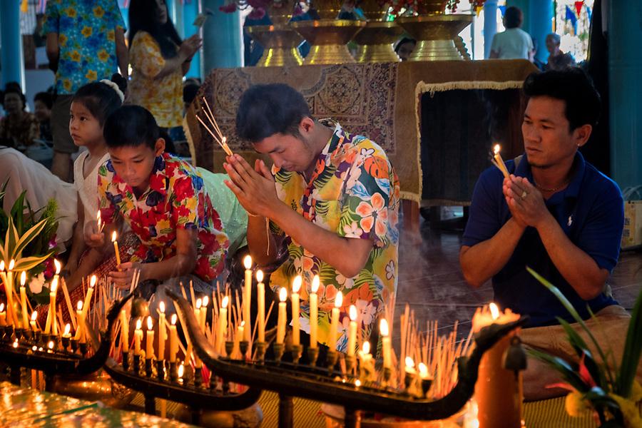 Devotees pray in the local temple as Songkran 2017 begins in rural Thailand. (Lee Craker/Lee Craker, Photographer)