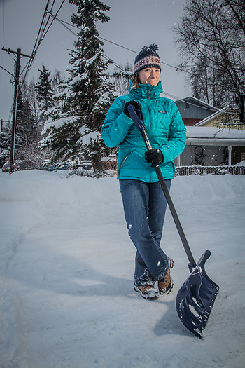 Third grade teacher, Erinn Turnock, takes a break from shoveling her driveway on 19th Avenue near Spenard Road, Anchorage. (Clark James Mishler)