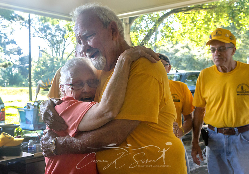 Homeowner Fay McDowell, of Zoar Baptist Church, hugs SBDR volunteer Gary Tracy, a member of Northern Hills Baptist Church in Holt, Mo., following a prayer meeting at her house, Aug. 22, 2016, in Baton Rouge, La. McDowell is one of thousands of Louisiana residents whose homes were damaged by floods last week. Tracy, along with other SBDR volunteers from Missouri, is helping tear out sheetrock and spray funigicide to prevent mold from growing. (Photo by Carmen K. Sisson) (Carmen K. Sisson/Cloudybright)