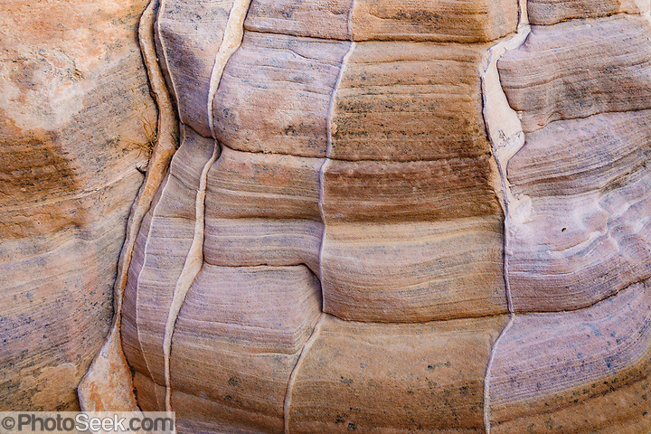 Sandstone rock patterns in Kaolin Wash, Valley of Fire State Park, near Moapa Valley, Nevada, USA. Starting more than 150 million years ago, great shifting sand dunes during the age of dinosaurs were compressed, uplifting, faulted, and eroded to form the park's fiery red sandstone formations. (© Tom Dempsey / PhotoSeek.com)