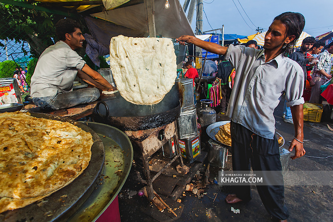 Kashmiri Parantha, being prepared on the streets of Kashmir. ..Devotees converged for peace prayers at the famous Muslim shrine of Hazratbal to mark Meraj-ul-Alam festival in Srinagar, Prophet Mohammed's Moi-e-Muqaddas (Holy Relic) is displayed for public viewing on ten occasions in a year, which includes Meraj-ul Alam. (Himanshu Khagta)