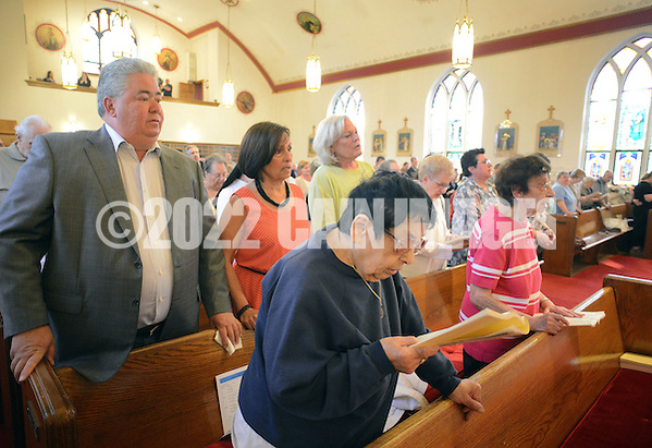 BRISTOL, PA - MAY 31:  From left, Ralph DiGuiseppe, Monica DiGuiseppe,  Robyn Trunell and in the foreground Ann Sidorak, all of Bristol, Pennsylvania continue worship after the closing of St. Ann's parish is announced May 31, 2014 in Bristol, Pennsylvania. The woman on the far right is unidentified. (Photo by William Thomas Cain/Cain Images) (William Thomas Cain)