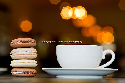 A stack of macaroons next to a cup of coffee at Meridienne Dessert Salon and Cafe in Rogers, Arkansas. (Beth Hall)