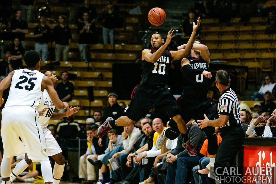 November 24th, 2013:  Harvard Crimson senior guard Brandyn Curry (10) and senior guard Laurent Rivard (0) jump out of bounds to attempt to save the ball in the first half of action in the NCAA Basketball game between the Harvard Crimson and the University of Colorado Buffaloes at the Coors Events Center in Boulder, Colorado (Carl Auer/ZUMAPRESS.com)