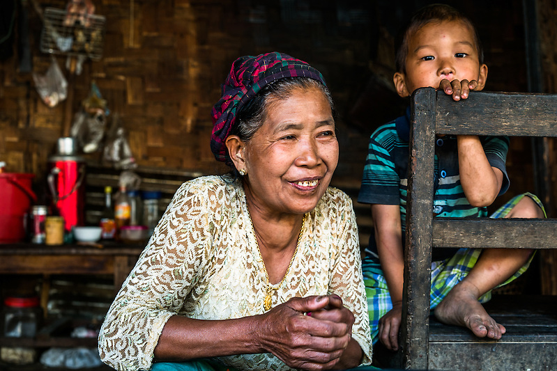 MYITKYINA, MYANMAR - MARCH 13th, 2016: Phaw La Htu, 61, a resident of Shwezet IDP village. She, her family of 14, and nearly 500 others were forced to relocate here in 2011 because of escalated fighting in her former village between the Kachin Independence Army, KIA, and the Burmese government, which has been in various states of conflict since 1994. She says she would love to return home, but will only do so when everyone does, as she's scared to be there alone. (Quinn Ryan Mattingly/For The Washington Post)