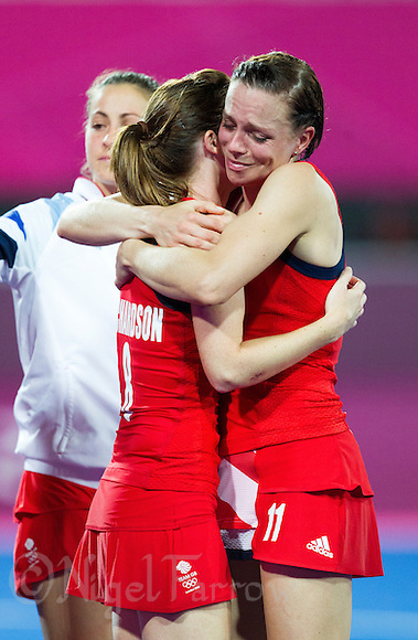 08 AUG 2012 - LONDON, GBR - Kate Walsh (GBR) (right) and Helen Richardson (GBR) console each other after Great Britain lost 2-1 to Argentina in the London 2012 Olympic Games semi final hockey match at the Riverbank Arena in Stratford, London, Great Britain (PHOTO (C) 2012 NIGEL FARROW) (NIGEL FARROW/(C) 2012 NIGEL FARROW)
