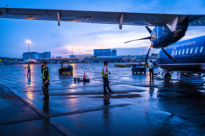 An early morning wet tarmac at Tan Son Nhat airport, Ho Chi Minh City, Vietnam. (Quinn Ryan Mattingly)