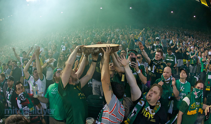 August 23, 2017; Portland, OR, USA; The Timbers Army passes a log slab through the crowd after Darlington Nagbe's goal at Providence Park. Photo: Craig Mitchelldyer-Portland Timbers (Craig Mitchelldyer, Craig Mitchelldyer)