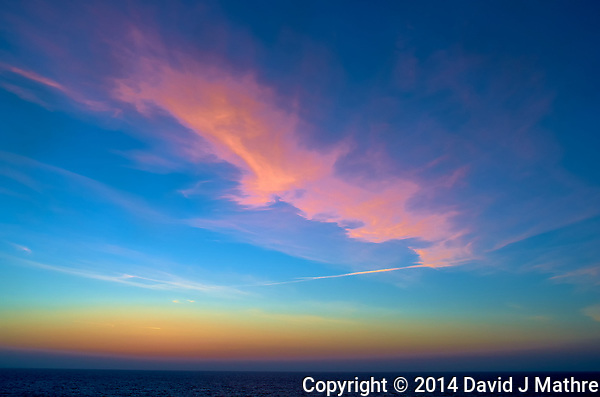 Pink clouds at dawn over the Atlantic Ocean from the deck of the MV Explorer. Image taken with a Leica X2 camera. (David J Mathre)