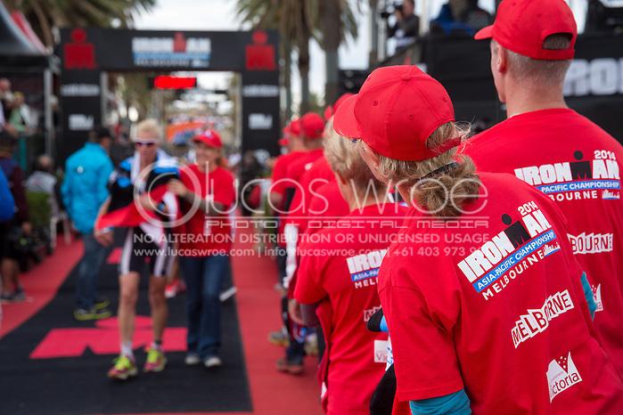 Age Group Competitors Finish, March 23, 2014 - Ironman Triathlon : Ironman Melbourne Race, Run Course Run Course Race Finish, St Kilda, Melbourne, Victoria, Australia. Credit: Lucas Wroe (Lucas Wroe)