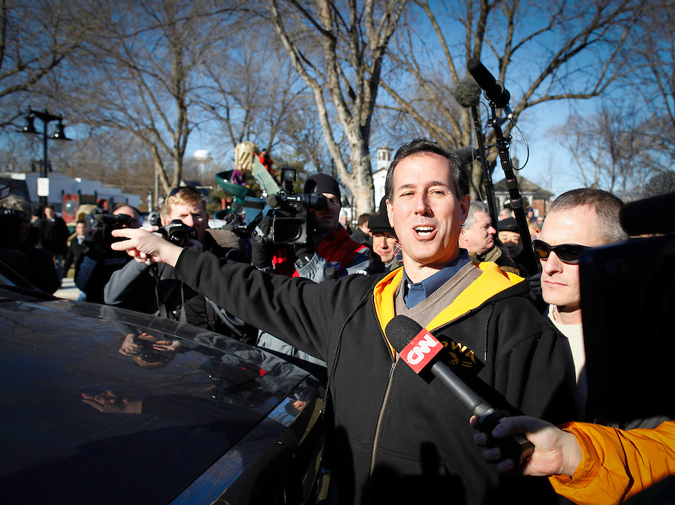 Rick Santorum points out the pleasures of traveling in a pickup truck during a campaign stop at a cafe in Polk City, Iowa on Monday, January 2, 2012.  (Christopher Gannon/GannonVisuals.com/MCT) (Christopher Gannon)