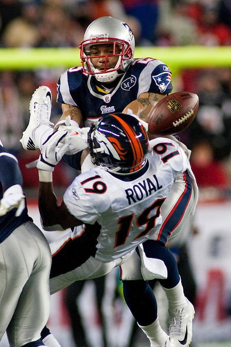 1/14/12 -- FOXBORO, Mass. -- Patriots safety Patrick Chung breaks up a pass intended for Broncos wide receiver Eddie Royal in the fourth quarter in the New England Patriots' 45-10 win over the Denver Broncos at Gillette Stadium in the AFC Divisional Playoffs on Jan. 14, 2012. (Kelvin Ma)