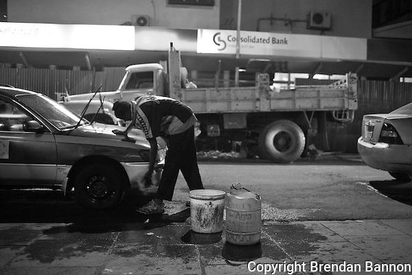 Car wash man John Mbogo, on a friday night in Naiorbi. (Brendan Bannon)