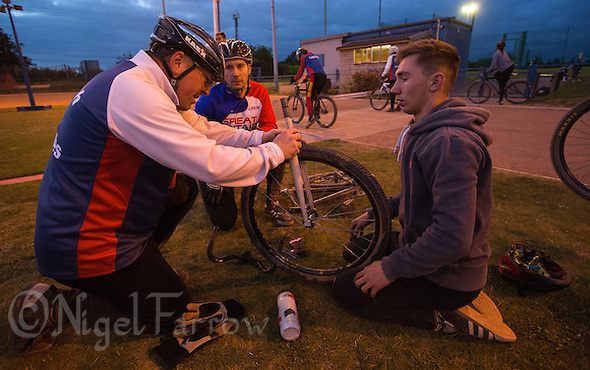 09 JUN 2015 - IPSWICH, GBR - Phil Clarke (left), Adam Peck (centre) and Ashley Hill (right) repair a bike during an Ipswich Cycle Speedway Club training session at Whitton Sports and Community Centre in Ipswich, Suffolk, Great Britain (PHOTO COPYRIGHT © 2015 NIGEL FARROW, ALL RIGHTS RESERVED) (NIGEL FARROW/COPYRIGHT © 2015 NIGEL FARROW : www.nigelfarrow.com)