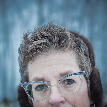 """Wendy Isbell and her daughters Tina and Becky in Anchorage's South addition neighborhood.  """"I have eight pairs of glasses.  I bought these in a thrift shop.""""  farbell@ak.net (© Clark James Mishler)"""