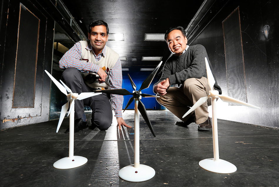 Anupam Sharma, left, and Hui Hu are using Iowa State's Aerodynamic/Atmospheric Boundary Layer Wind Tunnel to study dual-rotor wind turbines that would increase the energy harvest of wind farms. Turbine models are shown at foreground. (photo by Christopher Gannon) (Christopher Gannon)