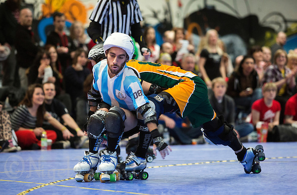16 MAR 2014 - BIRMINGHAM, GBR - Argentine jammer El Pibe avoids a challenge from Wizard of Aus blocker Flamin' Galah during the bout between the two teams at the inaugural Men's Roller Derby World Cup in the Futsal Arena in Birmingham, West Midlands, Great Britain (PHOTO COPYRIGHT © 2014 NIGEL FARROW, ALL RIGHTS RESERVED) (NIGEL FARROW/COPYRIGHT © 2014 NIGEL FARROW : www.nigelfarrow.com)